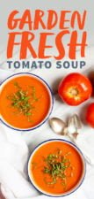 Overhead shot of Garden Fresh Tomato Soup on a white background, with whole tomatoes off to the side, with a text overlay