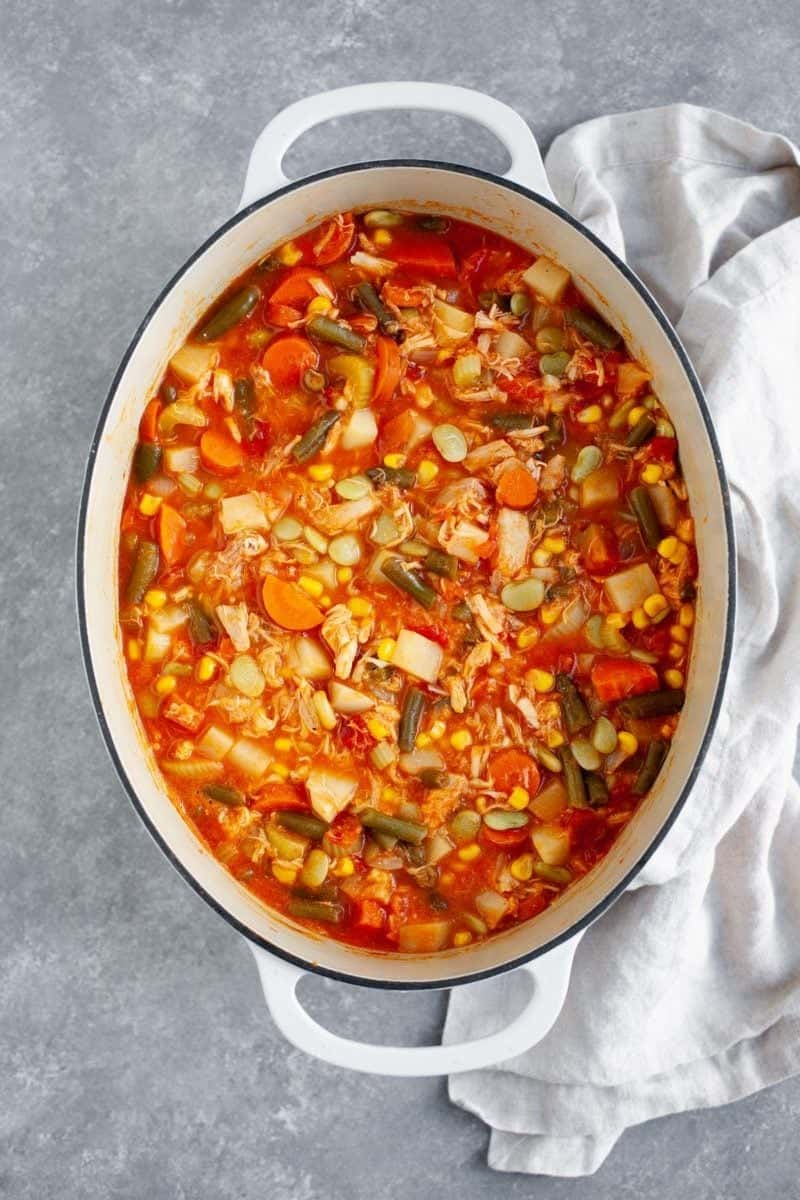 Turkey Vegetable Soup in a stockpot on a marbled background