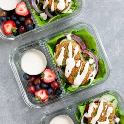 Meal Prep Baked Falafel Lettuce Wraps packed into glass lunch containers with mixed berries