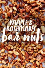 """Maple Rosemary Bar Nuts on a white background. A text overlay reads """"Maple & Rosemary Bar Nuts"""""""
