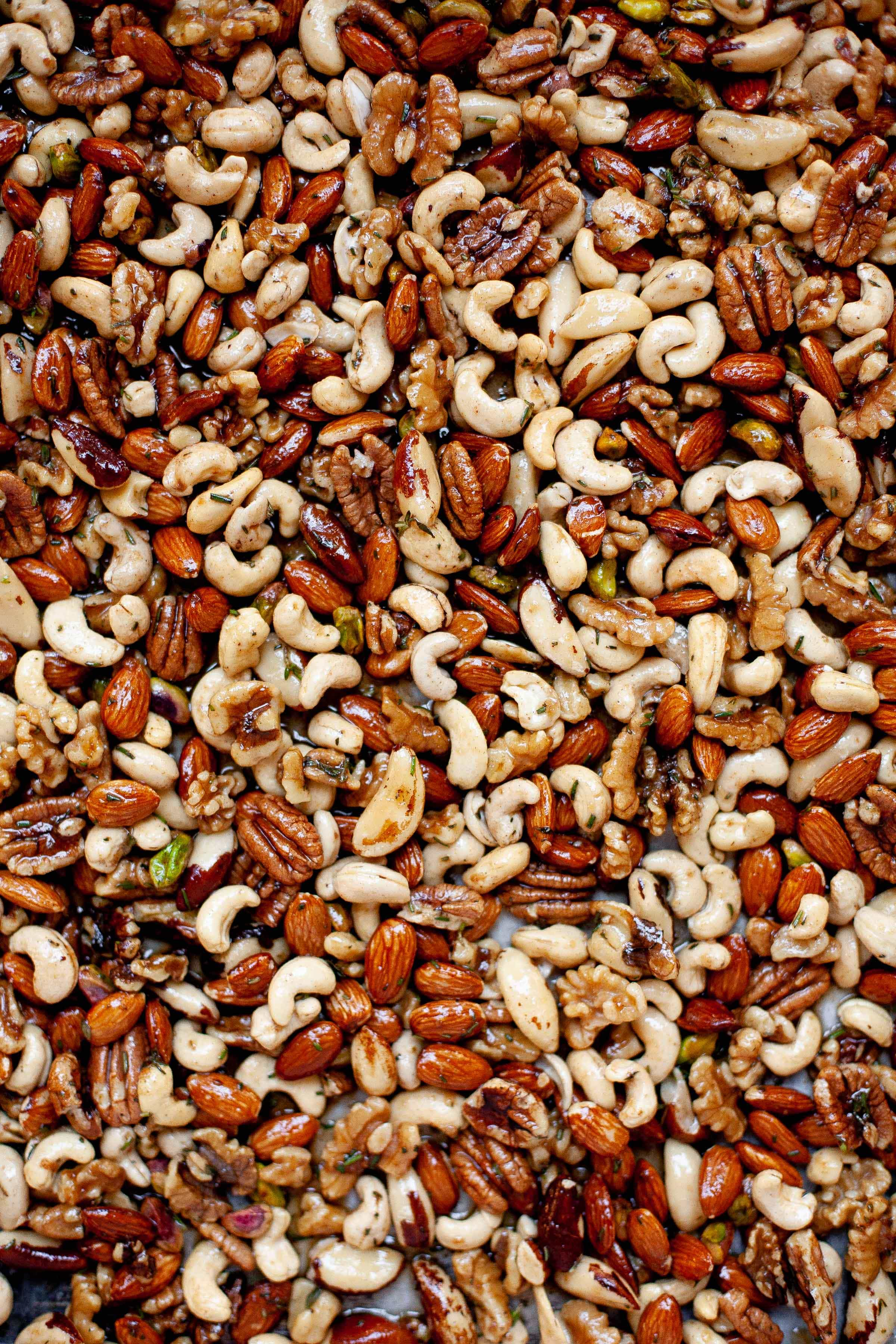 Mixed nuts sprinkled with seasoning and ready for roasting