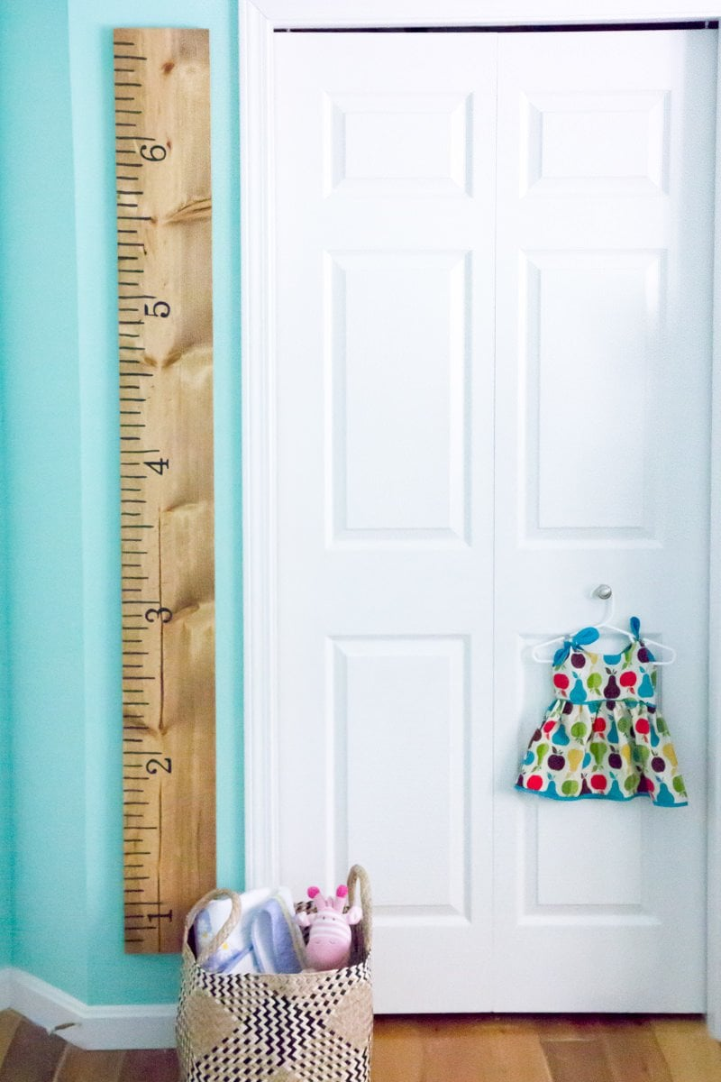tutorial giant ruler growth chart wholefullydiy growth chart ruler hanging on a turquoise wall next to a white door