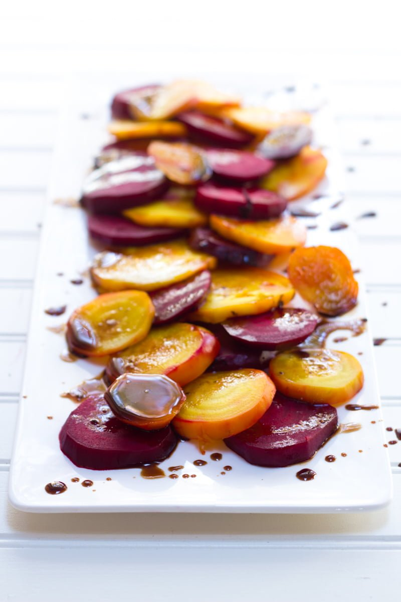 Balsamic Rainbow Roasted Beets on a rectangular white platter