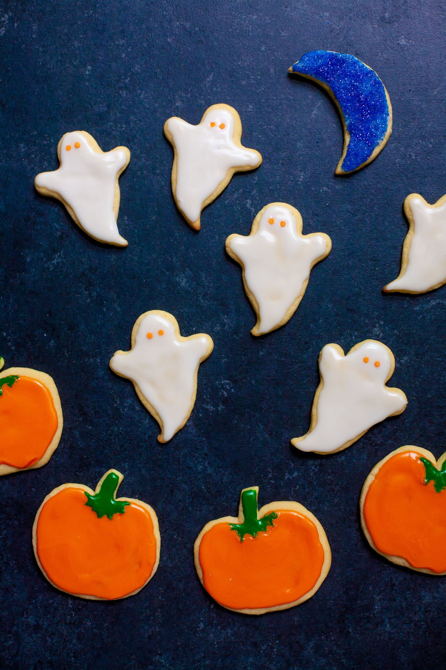 Overhead shot of frosted sugar cookies decorated for Halloween