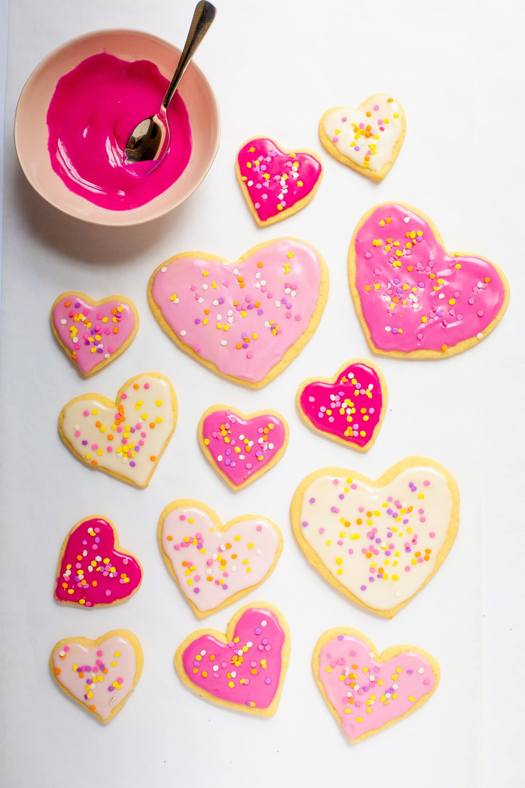 Overhead shot of frosted sugar cookies decorated for Valentine's Day