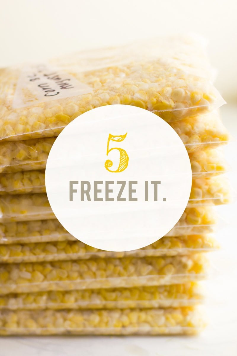 "Stack of zip-top bags filled with corn kernels. A text overlay reads ""5. Freeze It."""