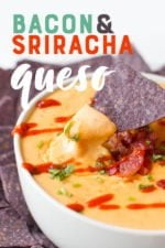 """Blue corn tortilla chip dipping into a white bowl of queso drizzled with sriracha. A text overlay reads """"Bacon & Sriracha Queso."""""""
