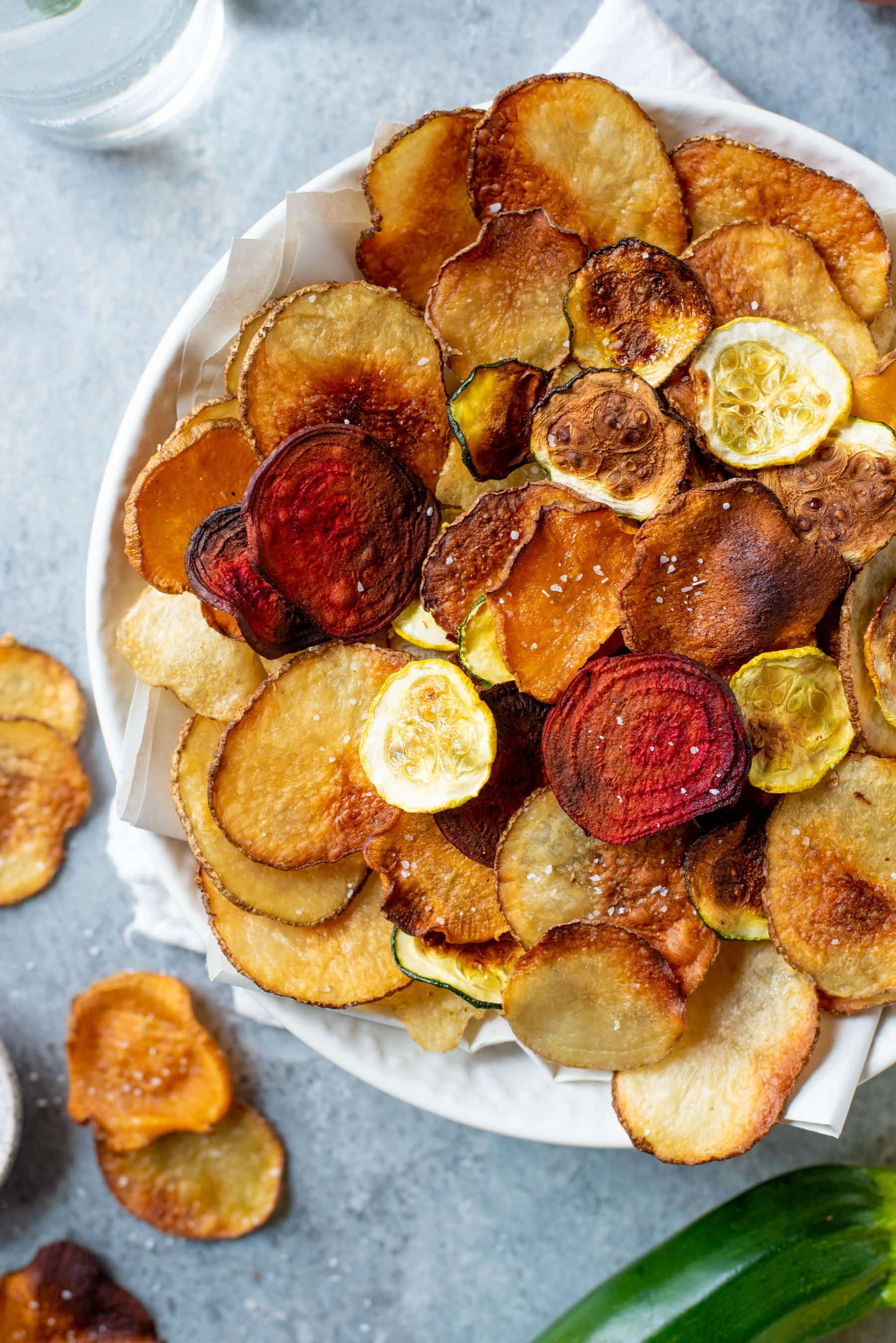 Close-up shot of Baked Vegetable Chips in a white bowl