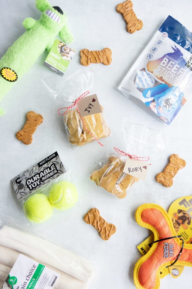 Grain-Free Pumpkin Coconut Dog Treats wrapped up for gifting, surrounded by dog toys