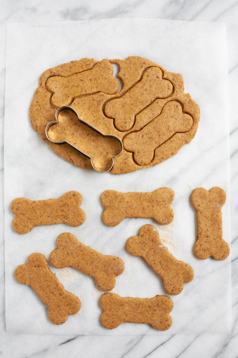 Cookie cutter cutting out bone shapes for Healthy Homemade Dog Treats