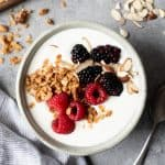 Overhead shot of 24-hour yogurt in a bowl, topped with granola and berries
