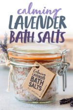 """Three glass jars of Calming Lavender Bath Salts with gift tags and sprigs of lavender. Text overlay reads """"Calming Lavender Bath Salts."""""""