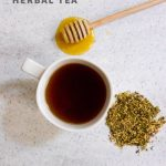 """Overhead shot of tea in a white teacup, with herbs and a honey dipper nearby. Text overlay reads """"Cold Care Herbal Tea."""""""