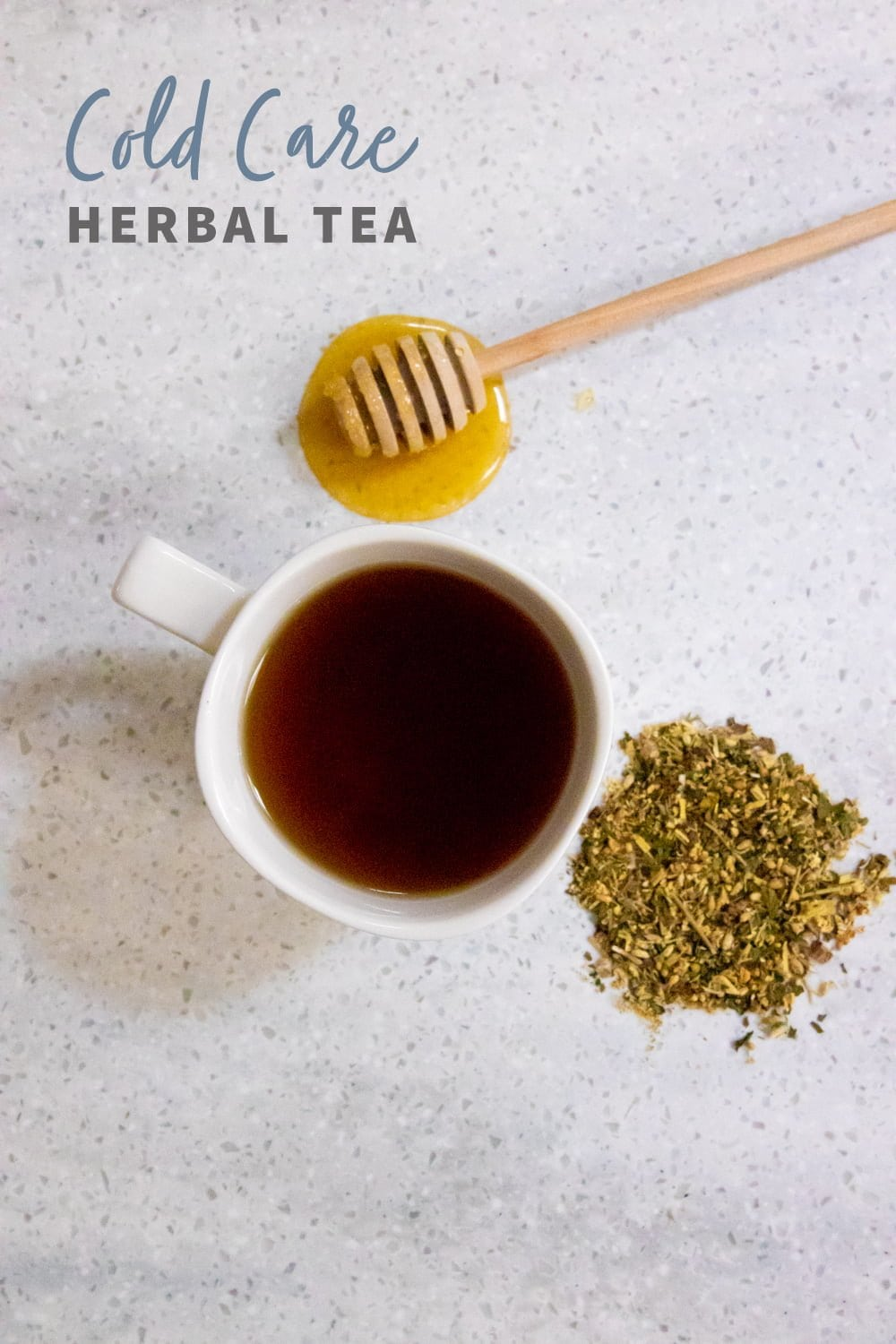 "Overhead shot of tea in a white teacup, with herbs and a honey dipper nearby. Text overlay reads ""Cold Care Herbal Tea."""