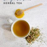 """Overhead shot of tea in a white teacup, with herbs and a honey dipper nearby. Text overlay reads """"Cough Be Gone Herbal Tea."""""""