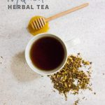 """Overhead shot of tea in a white teacup, with herbs and a honey dipper nearby. Text overlay reads """"NyQuell Herbal Tea."""""""