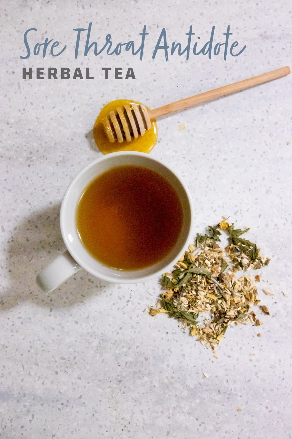 "Overhead shot of tea in a white teacup, with herbs and a honey dipper nearby. Text overlay reads ""Sore Throat Antidote Herbal Tea."""
