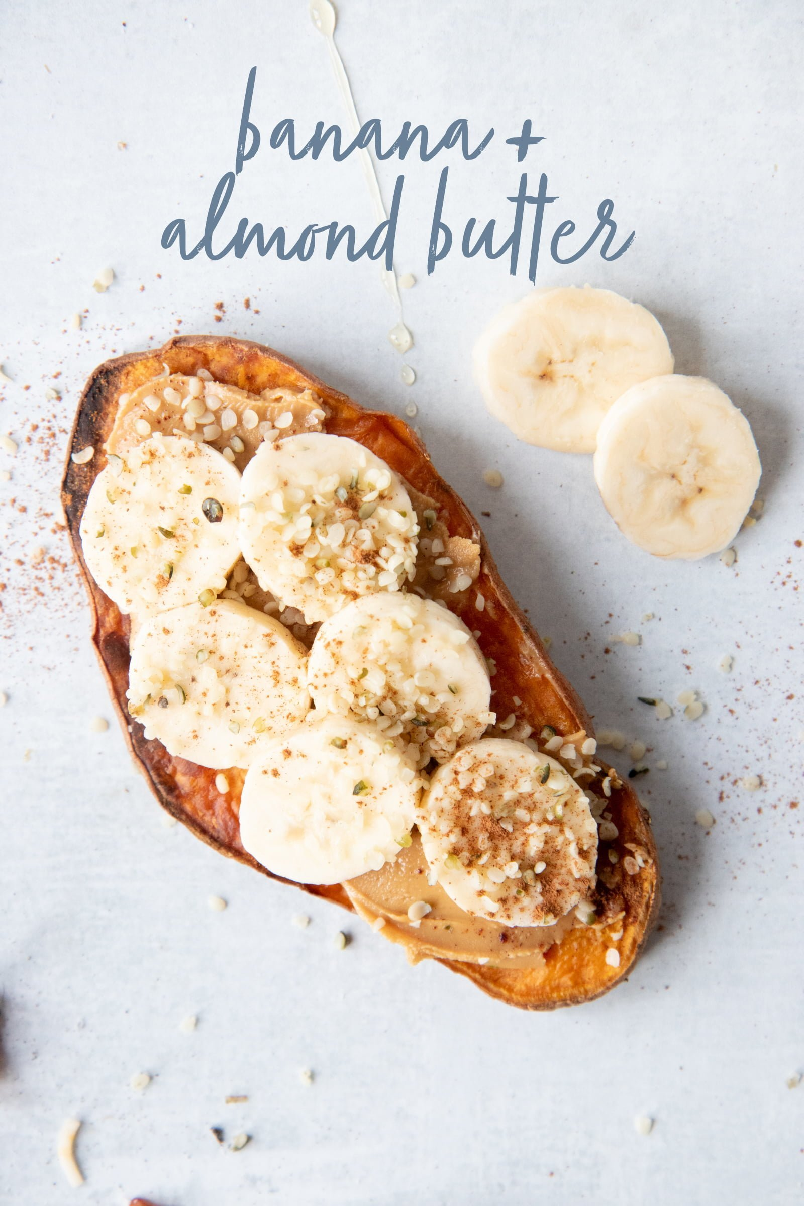 Sweet Potato Toast topped with almond butter and banana slices