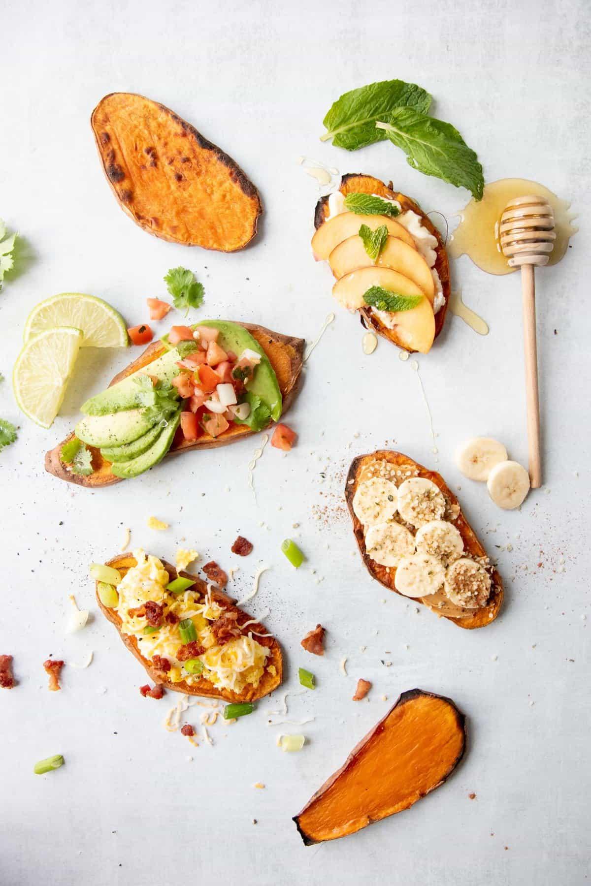 Four types of sweet potato arranged on a white background