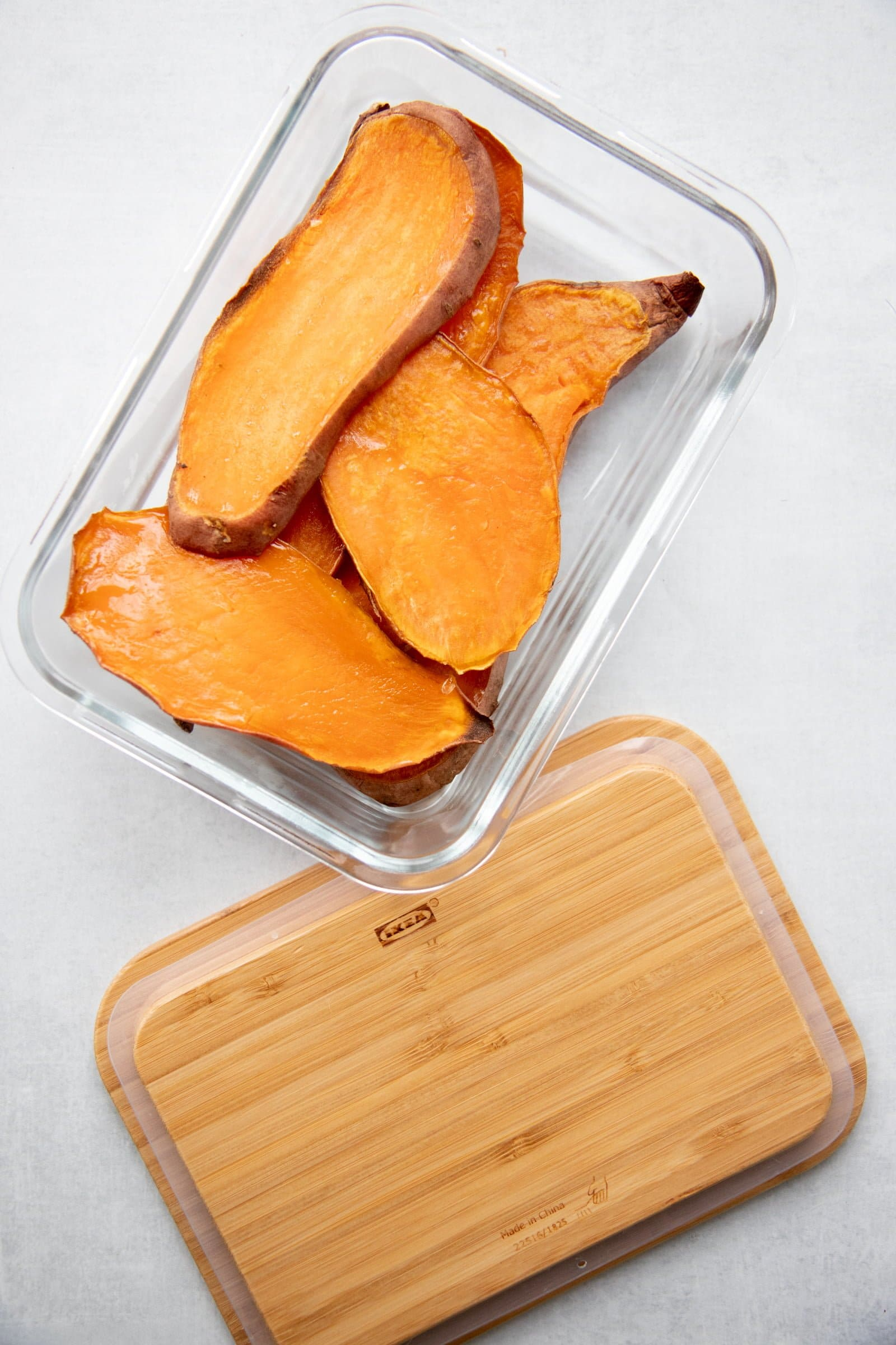 Sweet potato planks in a glass storage container
