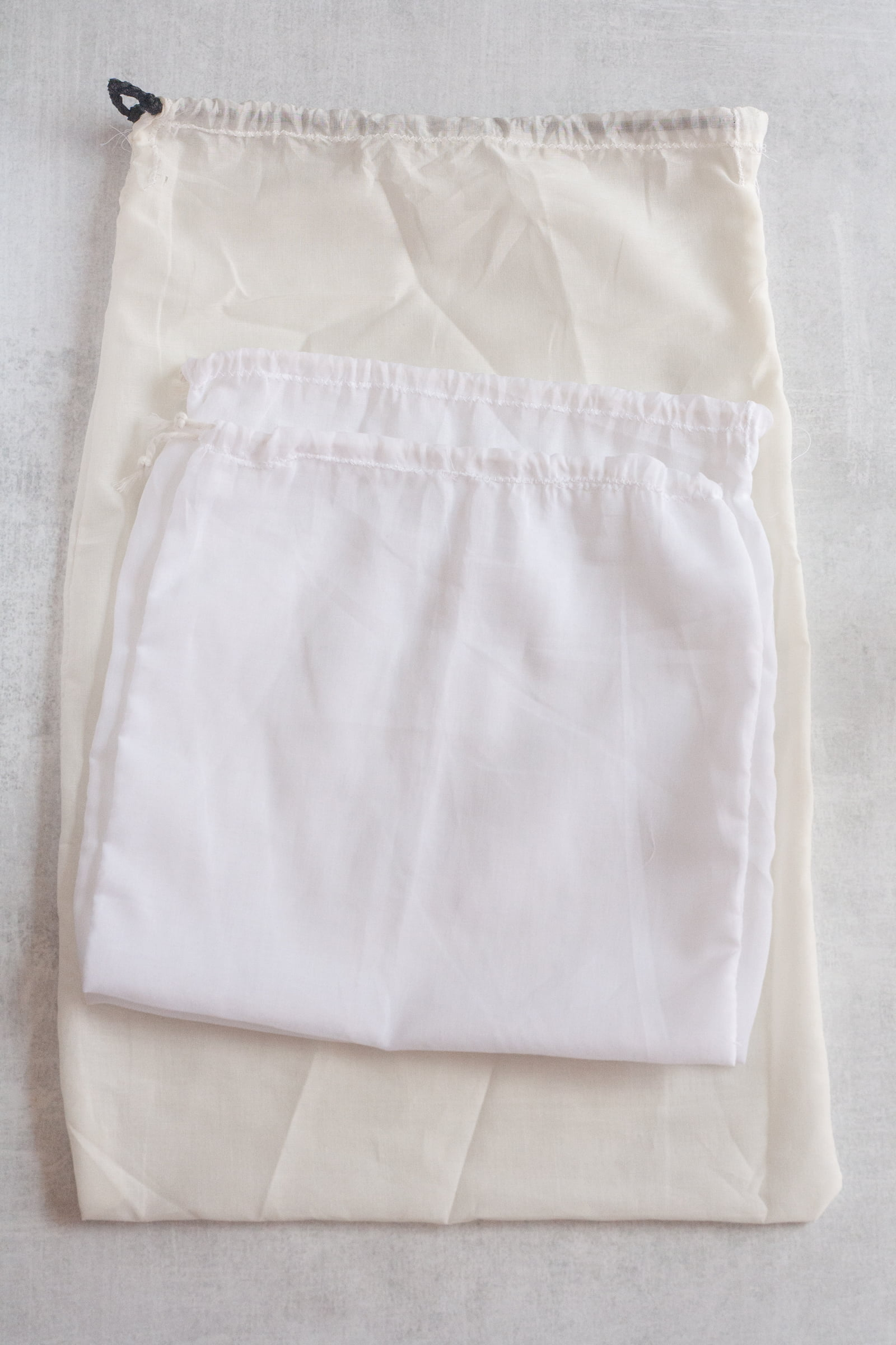 Three cotton voile drawstring bags stacked on top of each other